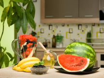 Healthy fruits on kitchen table Royalty Free Stock Photography