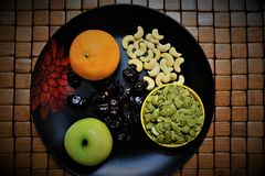 Healthy Fruits and Nuts. Fruits and nuts make the essential part of healthy breakfast. Source of vitamins, Minerals and Antioxidants royalty free stock photography