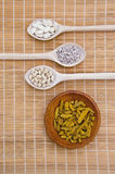 Healthy fruits and seeds in wooden plate and spoons Royalty Free Stock Image