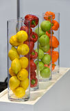 Healthy fruits and vegetables in vase Stock Photos