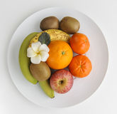 Healthy fruits on plate Stock Images