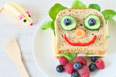 Healthy and fun food for kids. Happy and funny face sandwich Royalty Free Stock Photos