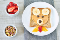 Healthy and fun snack for kids. Peanut butter Teddy bear face and banana sandwich Stock Photos