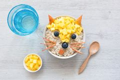 Healthy Funny Cute Breakfast For Kids. Oatmeal Porridge royalty free stock photography