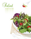 Healthy garden salad in stylish white bowl. Isolated on white Royalty Free Stock Photography
