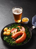Healthy German Recipe on a Pan with Beer on Side Royalty Free Stock Image