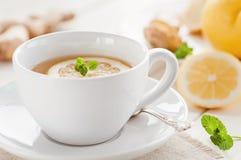 Healthy ginger-lemon tea. Healthy tea with fresh lemon and ginger Royalty Free Stock Photos