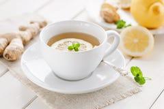 Healthy ginger-lemon tea. Healthy tea with fresh lemon and ginger Stock Image
