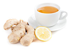 Healthy ginger tea. Cup of tea with ginger root and a slice of lemon  on white background Stock Photos