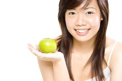 Healthy Girl 1. A healthy looking pretty asian woman holds an apple Stock Photo
