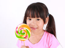 Healthy girl. Young asian girl with lollipop Royalty Free Stock Photography
