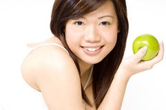 Healthy Girl 6. A healthy-looking pretty chinese girl in white holding a green apple stock photos