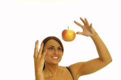 Healthy girl and apple Stock Photos