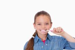Healthy girl brushing her teeth Stock Photo