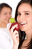 Healthy girl eating an apple Royalty Free Stock Images