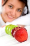 Healthy girl eating apples Royalty Free Stock Image