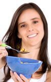Healthy girl eating cereal Royalty Free Stock Image