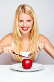 Healthy Girl eating an red apple Stock Photography