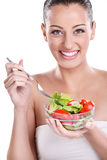 Healthy girl eating salad Royalty Free Stock Photo