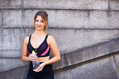 Healthy girl holding a water bottle Royalty Free Stock Photography