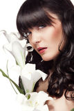 Healthy girl with orchid flower next to her on white background Stock Photo