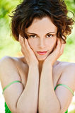 Healthy girl outdoors. Outside portrait of young beautiful brunette woman with fresh and clean skin Royalty Free Stock Photo