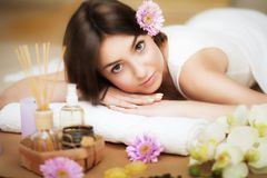 Beauty treatments. Spa and relaxation. Rest on the massage table after the massage. Aroma oil. Beautiful, well-groomed skin. The c Stock Photos