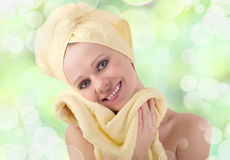 Healthy girl with yellow skin wipes with  towel Stock Photos