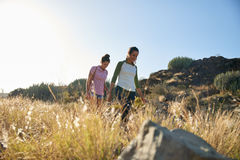 Healthy girls walking down a hill Stock Images
