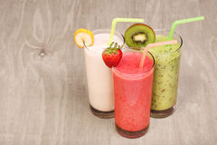 Healthy glass of smoothies collection flavor on wood. Background Stock Photography