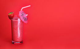 Healthy glass of smoothies strawberry flavor on red Royalty Free Stock Photography