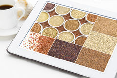 Healthy gluten free grains. Reviewing pictures of healthy gluten free grains (quinoa, kaniwa, brown rice, millet, amaranth, teff, buckwheat, sorghum) on a Stock Photo