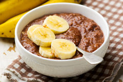 Healthy gooey chocolate banana oatmeal for breakfast. Selective focus Royalty Free Stock Images