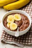 Healthy gooey chocolate banana oatmeal for breakfast. Selective focus Royalty Free Stock Photo
