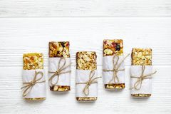 Healthy granola bars with nuts, seeds and dried fruits on the gray texture table, with copy space. Healthy breakfast on window sill homemade granola with nuts royalty free stock photo