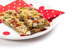 Healthy granola bars. On plate isolated on white Stock Photography