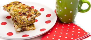 Healthy granola bars. On plate isolated on white Stock Photo