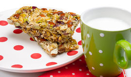 Healthy granola bars. On plate isolated on white Royalty Free Stock Image