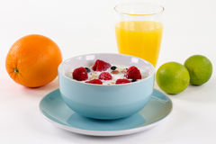 Healthy granola breakfast with orange juice, an orange and lemon Royalty Free Stock Photography