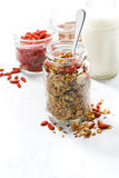 Healthy granola with goji berries in and white background Stock Photos