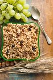 Healthy granola muesli breakfast with grape, nuts and wheat ears royalty free stock images