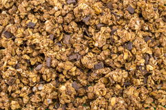 Healthy granola muesli cereals with chocolate background. Healthy granola muesli cereals with chocolate pieces background Royalty Free Stock Photos