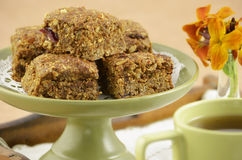 Healthy granola squares. Healthy homemade granola squares with mugs of tea on wooden tray Stock Photography