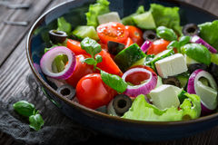 Healthy Greek salad with feta cheese, black olives and lettuce Royalty Free Stock Photography
