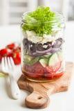 Healthy greek salad in mason jar. tomato olive feta onion Stock Photography