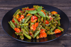 Healthy green beans, red cherry tomato with sesame seeds Royalty Free Stock Images