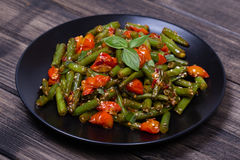 Healthy green beans, red cherry tomato with sesame seeds Stock Photography