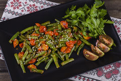 Healthy green beans, red cherry tomato with sesame seeds Royalty Free Stock Photo