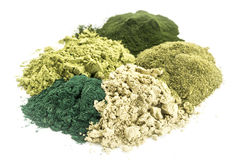 Healthy green dietary supplements. A pile of five healthy green dietary supplement powders (spirulina, chlorella, wheatgrass, kelp and moringa leaf Royalty Free Stock Photos