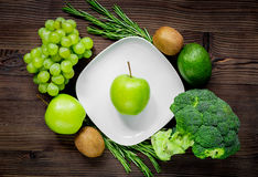 Healthy green food with fresh vegetables on wooden table background top view. Healthy green food with fresh vegetables on wooden kitchen table background top Royalty Free Stock Photo